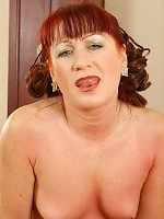 Red-haired old woman with small tits rides a hard cock