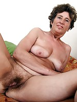 Granny with saggy tits spreads her hairy old pussy