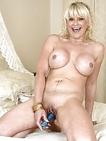 Big titted mature housewife gets busy with her vibrator