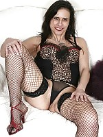 Sexy old woman in black stockings shows her lickable pussy