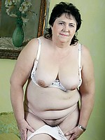 Full figured grandma lowers her big white panties and shows her old slit